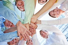 Hands stacked as symbol for teamwork Royalty Free Stock Image