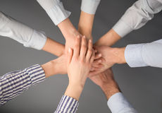Hands stacked in a pile. A symbol of teamwork and trust. Royalty Free Stock Photography