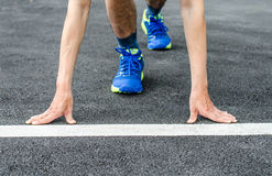 Hands on starting line , Male runner is about to start to run. Hands is on starting line , Male runner is about to start to run Royalty Free Stock Photography