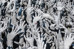 Hands statue from hell in Wat Rong Khun. Wat Rong Khun is a white temple close to Chiang Rai Royalty Free Stock Image
