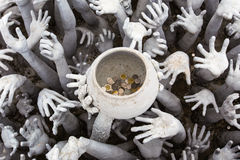 Hands Statue from Hell at White temple Royalty Free Stock Photos