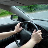 Hands on a steering wheel Stock Photography