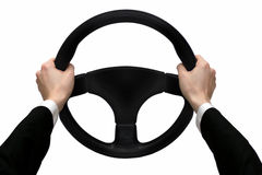 Hands on the steering wheel Stock Images