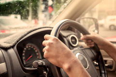 Hands on steering wheel of car driving Royalty Free Stock Images
