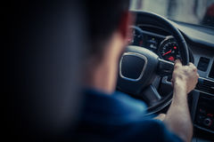 Hands on steering wheel Stock Image