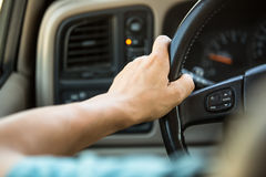 Hands on the steering wheel Stock Photography