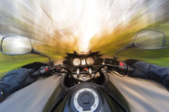 Hands on the steering wheel while driving a motorcycle Royalty Free Stock Photography