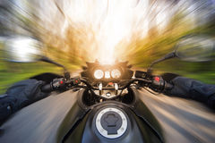 Hands on the steering wheel while driving a motorcycle Royalty Free Stock Photo