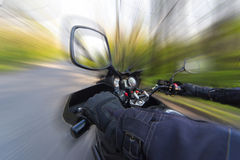 Hands on the steering wheel while driving a motorcycle Royalty Free Stock Image