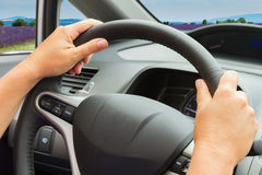 Hands with steering wheel Stock Images