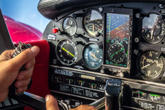 Hands on Stick in Aircraft Cabin During Cruise Flight Royalty Free Stock Images