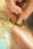 Hands Stitching Gold-Threaded Embroidery Royalty Free Stock Photos