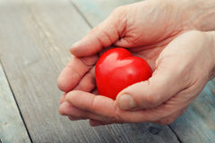 Hands with stone heart Royalty Free Stock Photos