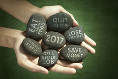 Hands with stones and resolutions Royalty Free Stock Photography