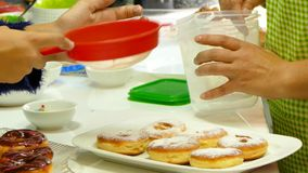 Sprinkle the donuts with powdered sugar stock video