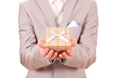 Hands stretched with a present box Royalty Free Stock Photo