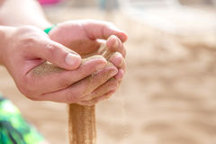 Hands strew sand running Stock Photos