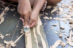 Hands striping glue from parquet Stock Photo
