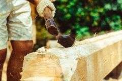 A man cuts a log Royalty Free Stock Photography