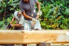 A man cuts a log Royalty Free Stock Photo