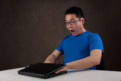 Hands stuck in laptop computer Stock Photo