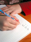 Hands student homework Royalty Free Stock Images