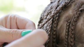 Hands stylist braid dreadlocks girl teen stock video