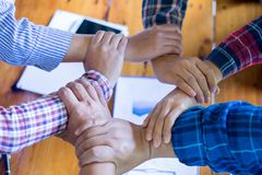 Hands of success startup business teamwork. Creative idea teamwork concept. Group of multiethnic diverse team royalty free stock photo
