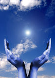 Hands with sun flare Royalty Free Stock Image