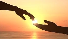 Hands and sunset Stock Photos