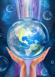 Hands support Earth in flow of life-giving energy Royalty Free Stock Photography