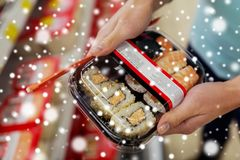 Hands with sushi pack at grocery or supermarket Stock Image