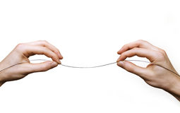 Hands suspending wire Royalty Free Stock Photography