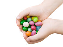 Hands with sweets Stock Image