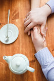 Hands on the table in cafe Stock Image