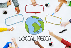 Hands on Table with Social Media Concepts royalty free stock image