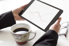 Hands with tablet analyzing diagram Stock Image