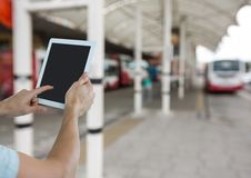 Hands with tablet in the bus station Stock Images