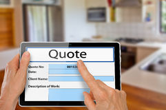 Hands with Tablet Kitchen Renovation Quote. Hands with Computer Tablet using Quotation App to complete Kitchen Renovation Quote Online Stock Image