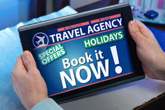 Hands on a tablet looking at a page online travel agency Royalty Free Stock Image