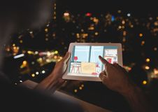 Hands with tablet at night in a balcony. Blue, red and white blueprint Royalty Free Stock Images