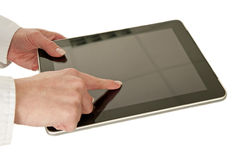 Hands on tablet pc Stock Photos