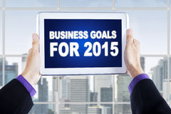 Hands with tablet showing business goals for 2015 Stock Images