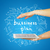 Hands, tablet and sketches business plan Stock Photography