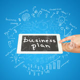 Hands, tablet and sketches business plan Royalty Free Stock Images