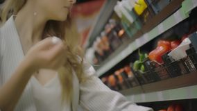 Hands take few colorful pepper one by one in marketplace and hold. Close up concept of selection, buy quality fruit or. Red vegetables. Young woman pick up some stock video