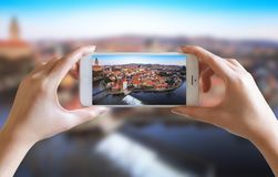 Hands take photo of village scenery view with mobile royalty free stock photos