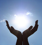 Hands take the power of sun stock images