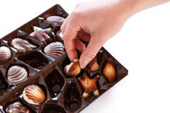Hands taking chocolate candy in box Stock Photography