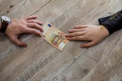 Hands taking and giving euro banknotes stock photos